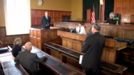 Barrister questioning Witness in court (USA flag) video