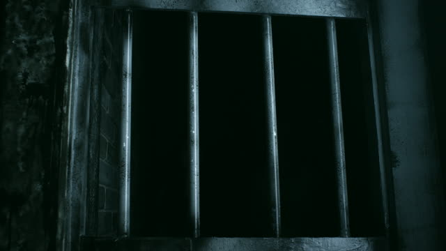 Bars on empty prison cell video
