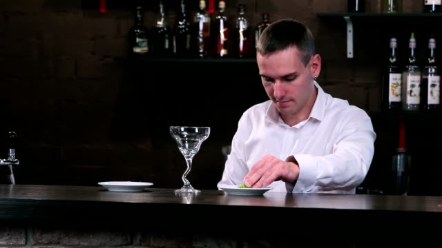 Bartender at work behind the bar video