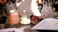 Bartender flambé candy on exotic drink video