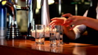 Bartender in uniform cleaning video