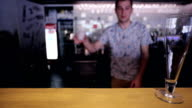 Bartender is adding ice in wineglass at bar counter video