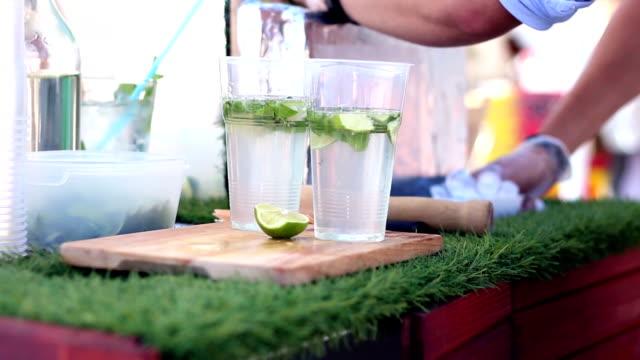Bartender making fresh lemonade on street food festivale video