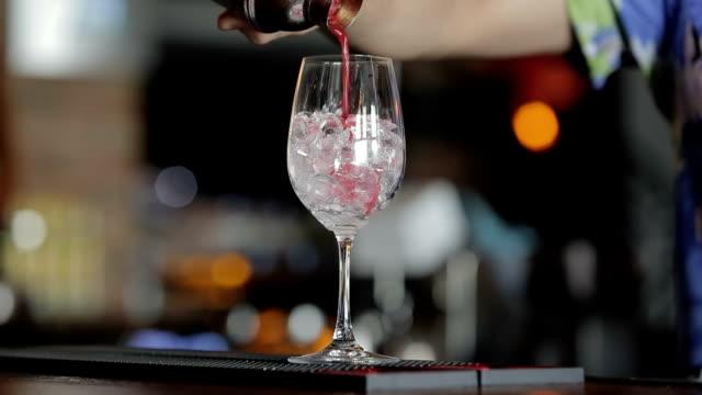 Bartender making red cocktail video