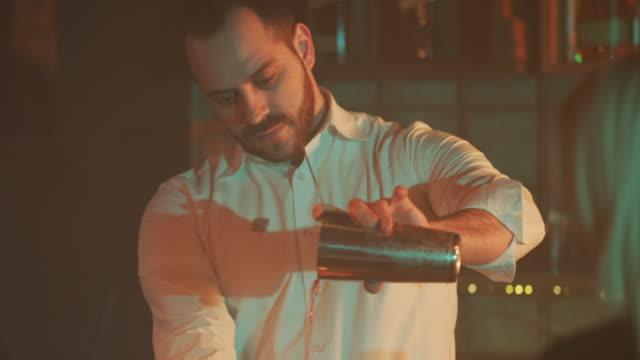 Bartender pouring drink 4K video