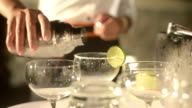 bartender pouring drinks into prepared glass video