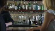 Bartender serves drinks and talks to customers video