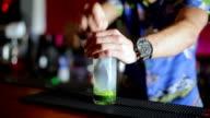Bartender stirring cucumber mojito video