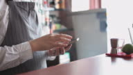 Bartender with mobile phone video