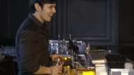 bartender working and talking to customers video