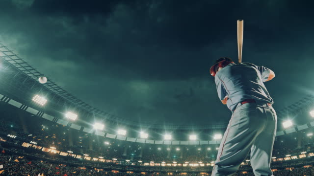 Baseball batter hitting a ball during game video