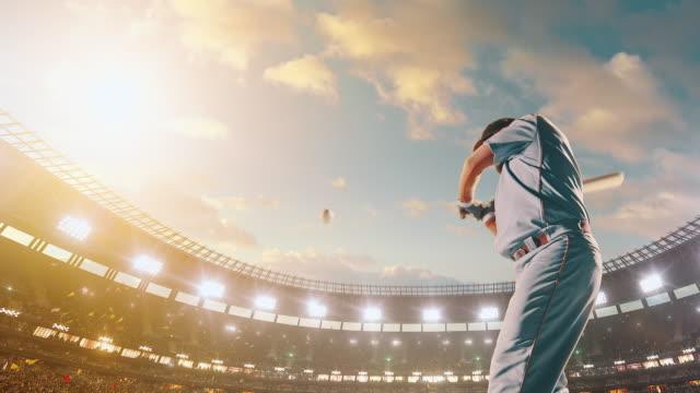 Baseball batter hitting ball during game video