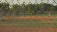 Baseball field shot from behind a fence video