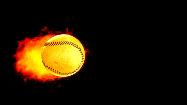 Baseball fireball in flames on black background video