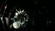 Baseball hitting glass window, slow motion video