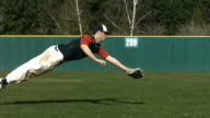 Baseball player catching ball, slow motion video