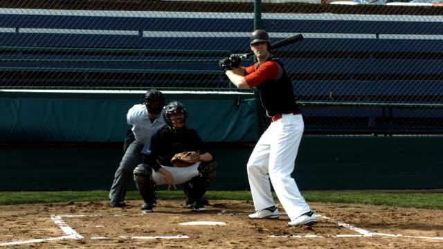 Baseball player hitting ball, slow motion video