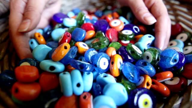 basket of colorful Turkish evil eye beads video
