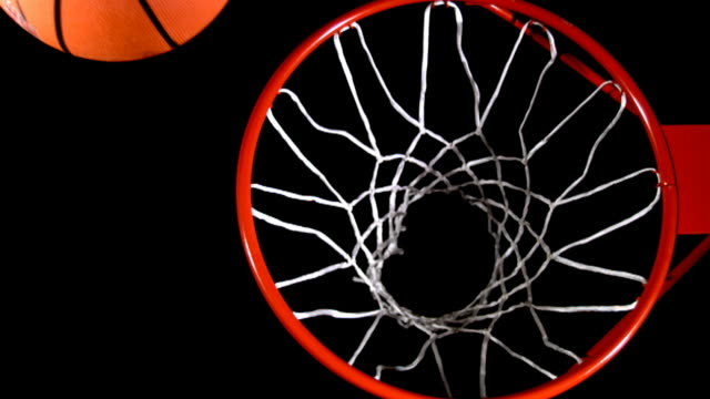 Basketball into hoop, slow motion video