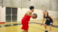 A basketball player dribbles down the court during a game and makes a basket video
