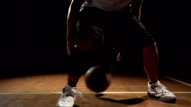 Basketball player dribbles in place. video