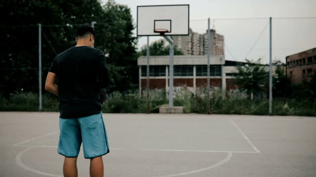 Basketball player exercising on basketball court. video