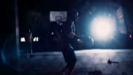 Basketball Player Practicing Alone on Court at Night video