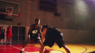 Basketball teammates playing one one one, running drills before a game video