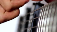 Bass guitar playing, close up video on white background video