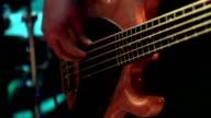 Bass-guitarist perform at a concert video