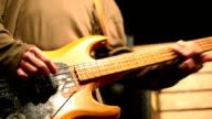 Bassist rehearsing in a studio video