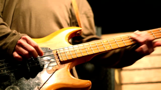 Bassist rehearsing in a studio video
