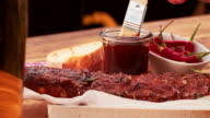Basting being painted onto a tasty looking rack of ribs video