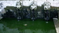 Bathing Temple Figures of the ancient temple of Pura Gua Gajah in Bali Island, Indonesia. Elephant Cave video