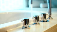 Bathtub faucet with running water, camera moving, selective focus. video