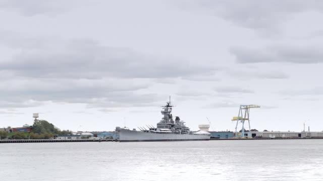 Battleship on Delaware River seen from Philadelphia video