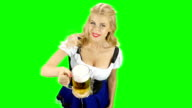 Bavarian girl offer someone a glass of beer and smiling. Green screen video
