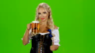 Bavarian girl with beer showing thumbs up. Green screen video