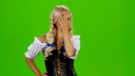 Bavarian sexy woman playing with her hair curl. Green screen video