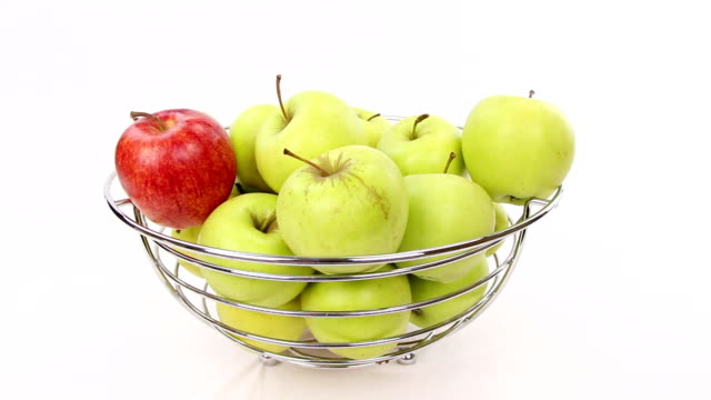 be different chooses red apple from bowl with green apples video