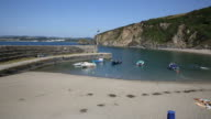 Beach and harbour Polkerris Cornwall England near St Austell and Par uk video