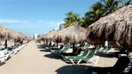 Beach cabana umbrella lounge chairs tropical vacation HD video