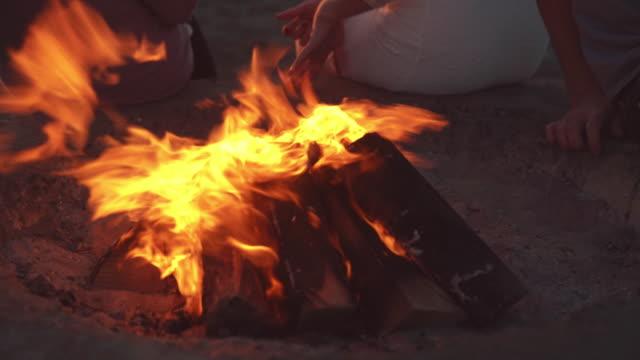Beach campfire at sunset video