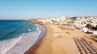 Beach of Praia da Luz at morning, Lagos, Algarve, Portugal aerial view video