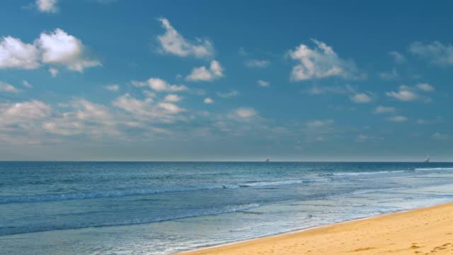 Beach scene showing sand, sea and sky video