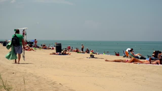 Beach scene with sun bathers video