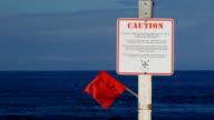 Beach warning sign dangerous ocean waters video