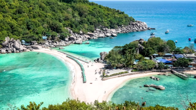 Beach with arriving tourist and sunbed on Koh Nangyuan Island on bright sunny day surraunded by beautiful crystal clear blue water, Surat Thani, Thailand video