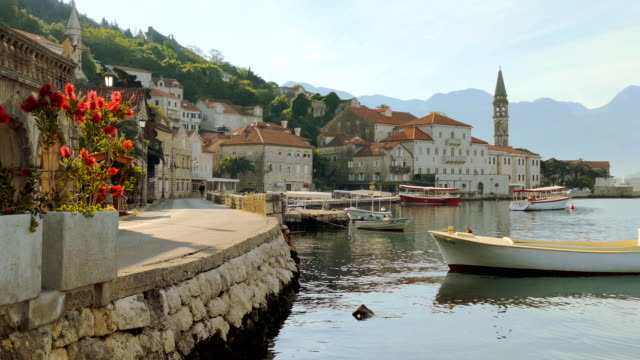 Beach with boats in the town of Perast, in Montenegro video