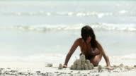 Beach Woman Sand Castle video